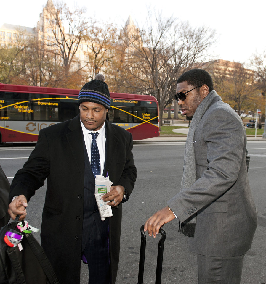 New Orleans Saints football defensive end Will Smith, left, and linebacker Jonathan Vilma arrive at an attorney\'s office in Washington, Friday, Nov. 30, 2012, for a hearing on their appeals of bounties suspensions. Friday\'s session is part of the latest round of player appeals overseen by former NFL Commissioner Paul Tagliabue. (AP Photo/Cliff Owen)