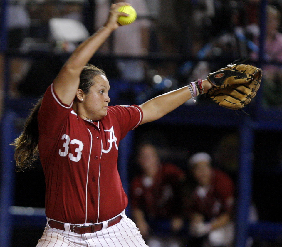Photo - Alabama's Jackie Traina (33) pitches against Oklahoma during the championship game of the Women's College World Series as ASA Stadium in Oklahoma City, Tuesday, June 5, 2012. Photo by Bryan Terry, The Oklahoman
