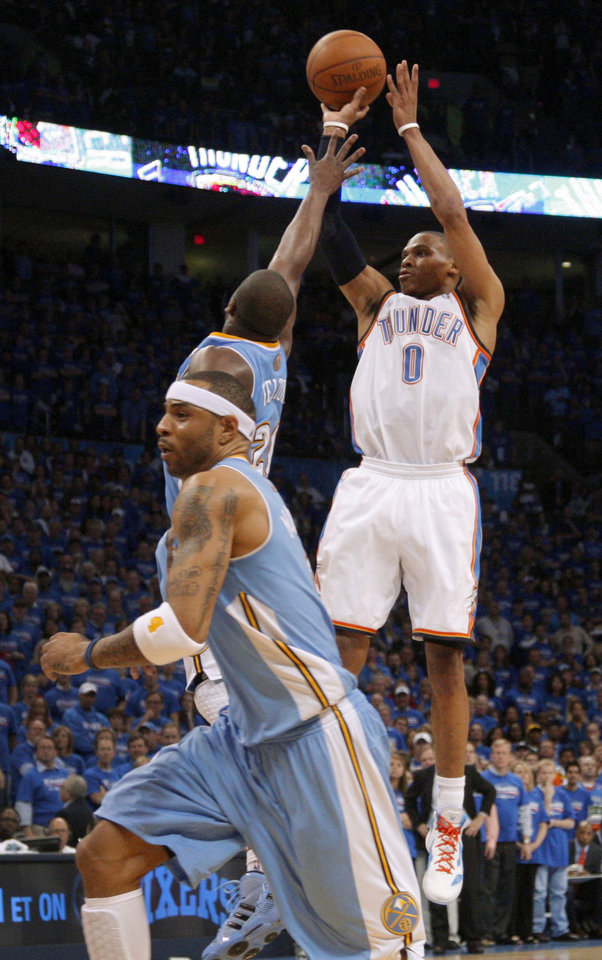 Photo - Oklahoma City's Russell Westbrook (0) hits a basket over Denver's Raymond Felton (20) in the final seconds of the NBA basketball game between the Denver Nuggets and the Oklahoma City Thunder in the first round of the NBA playoffs at the Oklahoma City Arena, Sunday, April 17, 2011. Photo by Bryan Terry, The Oklahoman