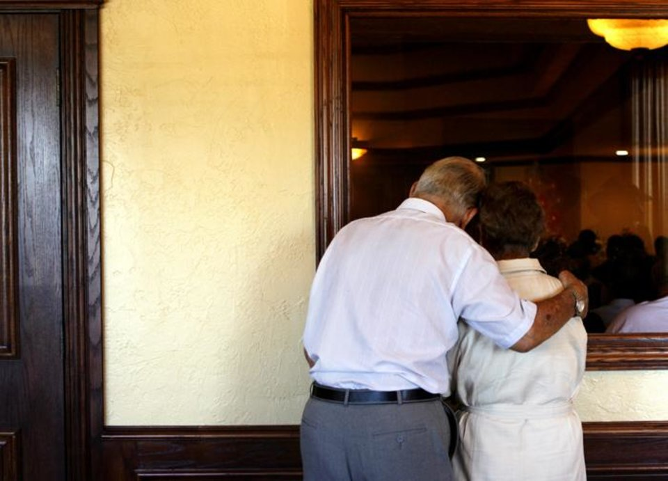 Photo -  ALLIE ELIZABETH CROOM / DROWN: Joseph Marcotte, left, and his wife Bernice Marcotte, who is the great-grandmother of Allie Croom, watch Croom's funeral service through a window at the Hibb's Funeral Home in Choctaw, Oklahoma June 23, 2009. Croom's death is under investigation and her mom's boyfriend is accused of drowning her last Thursday.  Photo by Ashley McKee, The Oklahoman   ORG XMIT: KOD