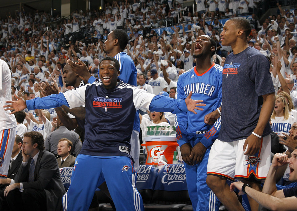 Photo - Oklahoma City's Nate Robinson (3)and the Thunder bench celebrate during game five of the Western Conference semifinals between the Memphis Grizzlies and the Oklahoma City Thunder in the NBA basketball playoffs at Oklahoma City Arena in Oklahoma City, Wednesday, May 11, 2011. Photo by Sarah Phipps, The Oklahoman