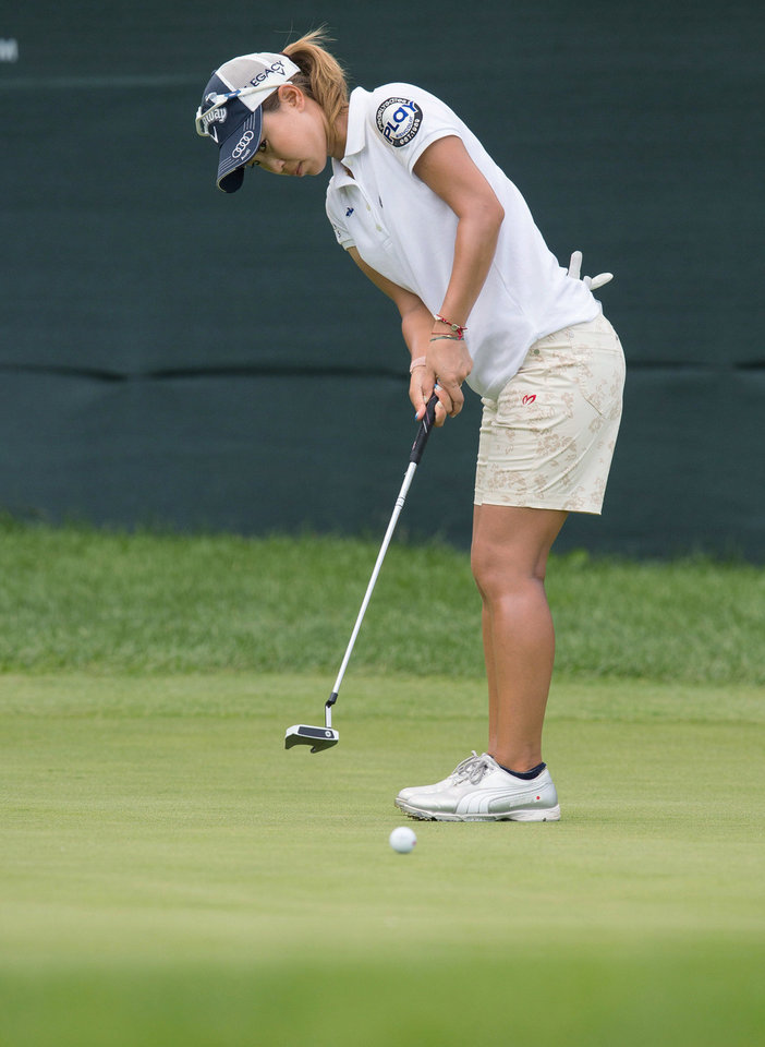 Photo - Momoko Ueda, of Japan, putts on the 18th green during the final round of the Manulife Financial LPGA Classic golf tournament in Waterloo, Ontario, on Sunday, July 14, 2013. (AP Photo/The Canadian Press, Geoff Robins)