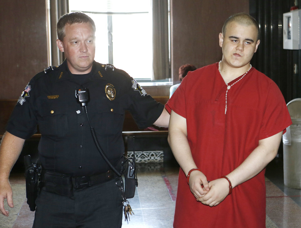 Photo - Tristan Owen is escorted fto his sentencing in the Oklahoma County Courthouse in Oklahoma City on Friday. A judge sentenced 17-year-old Tristan Owen to six years in prison for setting an early morning fire that killed an elderly couple in their south Oklahoma City home. Photo By Steve Gooch, The Oklahoman  Steve Gooch