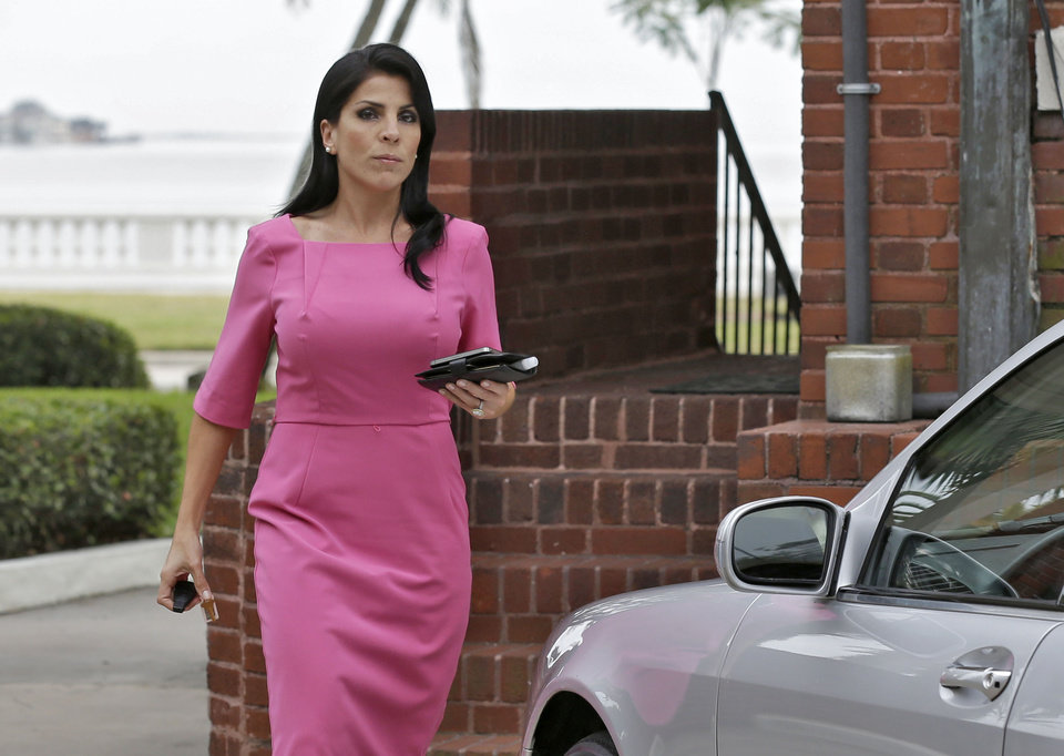 Jill Kelley leaves her home Tuesday, Nov 13, 2012 in Tampa, Fla. Kelley is identified as the woman who allegedly received harassing emails from Gen. David Petraeus\' paramour, Paula Broadwell. She serves as an unpaid social liaison to MacDill Air Force Base in Tampa, where the military\'s Central Command and Special Operations Command are located. (AP Photo/Chris O\'Meara)