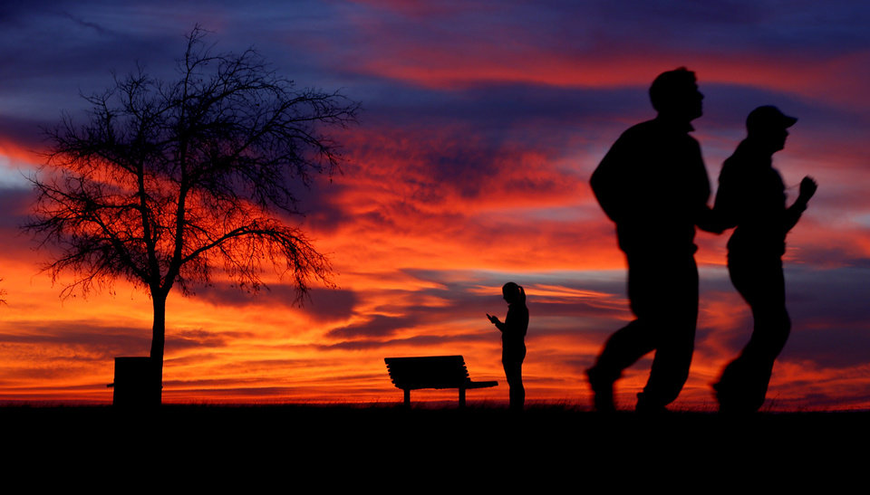 People jog along the shore of Lake Hefner just after sunset in Oklahoma City, Wednesday, Jan. 23, 2013. Photo by Bryan Terry, The Oklahoman