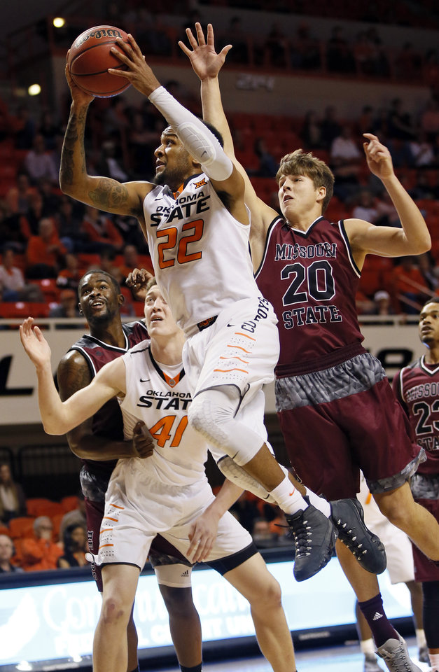 Photo - OSU's Jeff Newberry (22) takes the ball past Missouri State's Ryan Kreklow (20) as OSU's Mitchell Solomon (41) battles for position with Missouri State's Jordan Martin (25) during a men's college basketball game between Oklahoma State and Missouri State at Gallagher-Iba Arena in Stillwater, Okla., Saturday, Dec. 5, 2015. Missouri State won 64-63. Photo by Nate Billings, The Oklahoman