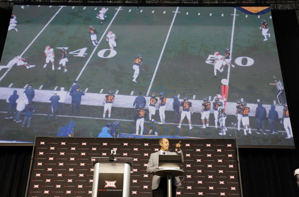 Photo - Big 12 Coordinator of Officials Greg Burks describes rule changes for the upcoming season during Big 12 Conference NCAA college football media day Tuesday, July 16, 2019, at AT&T Stadium in Arlington, Texas. (AP Photo/David Kent)