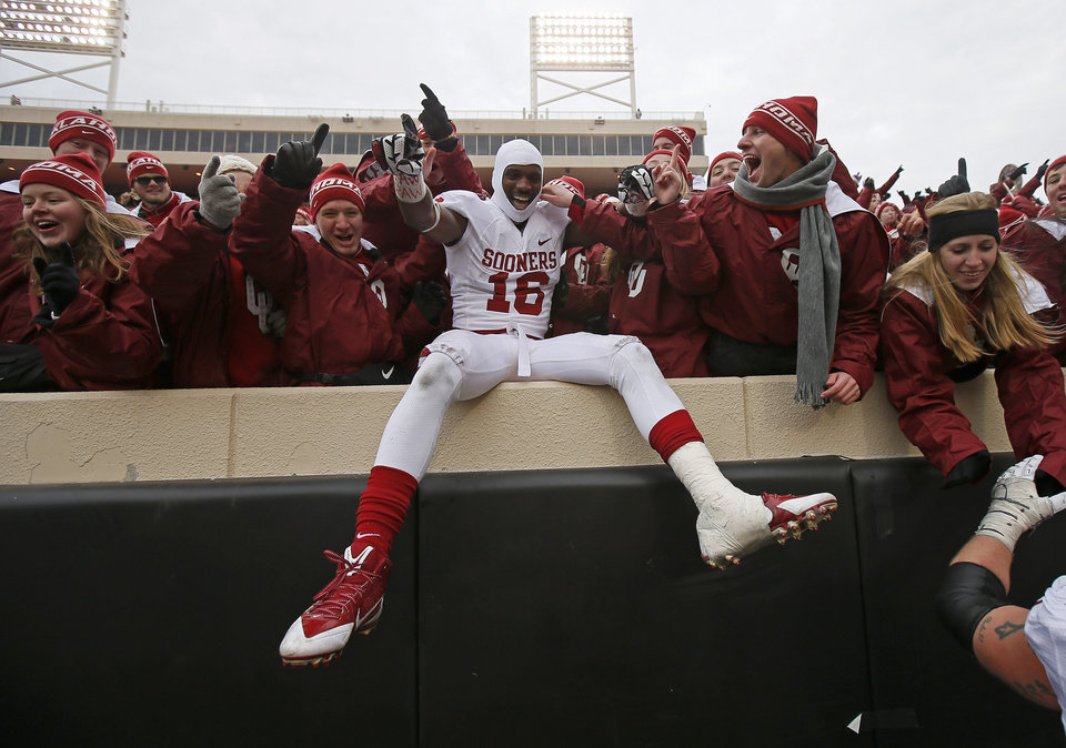 Photo - Oklahoma's Jaz Reynolds (16) celebrates after the Bedlam college football game between the Oklahoma State University Cowboys (OSU) and the University of Oklahoma Sooners (OU) at Boone Pickens Stadium in Stillwater, Okla., Saturday, Dec. 7, 2013. Oklahoma won 33-24. Photo by Bryan Terry, The Oklahoman