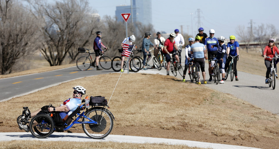 Photo - Cyclists gathered to celebrate the completion of the Will Rogers Trail. [PHOTO BY JIM BECKEL, THE OKLAHOMAN]