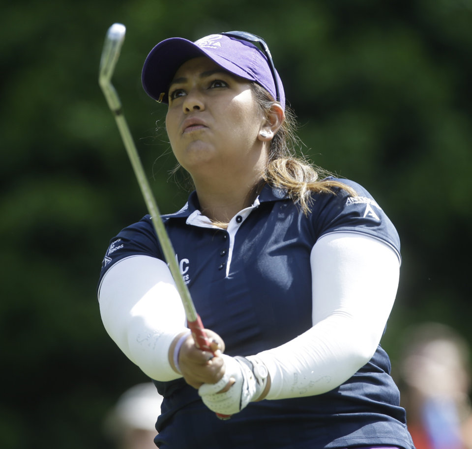 Photo - Lizette Salas watches her tee shot not eh fifth hole during the final round of the Kingsmill Championship golf tournament at the Kingsmill resort  in Williamsburg, Va., Sunday, May 18, 2014.  Salas birdied the par-3 hole.  (AP Photo/Steve Helber)
