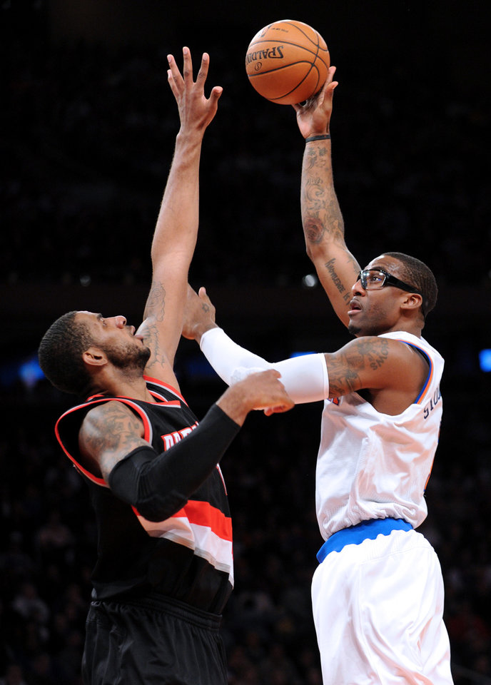 New York Knicks' Amare Stoudemire, right, shoots over Portland Trail Blazers' LaMarcus Aldridge during the second quarter of an NBA basketball game Tuesday, Jan. 1, 2013, at Madison Square Garden in New York. (AP Photo/Bill Kostroun)