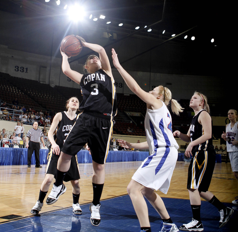Photo - Copan's Kendra Chinn shoots over Chattanooga's Ali Brown during the girls Class A high school playoff game between Copan and Chattanooga, Thursday, March 4, 2010, at the State Fair Arena in Oklahoma City. Photo by Sarah Phipps, The Oklahoman