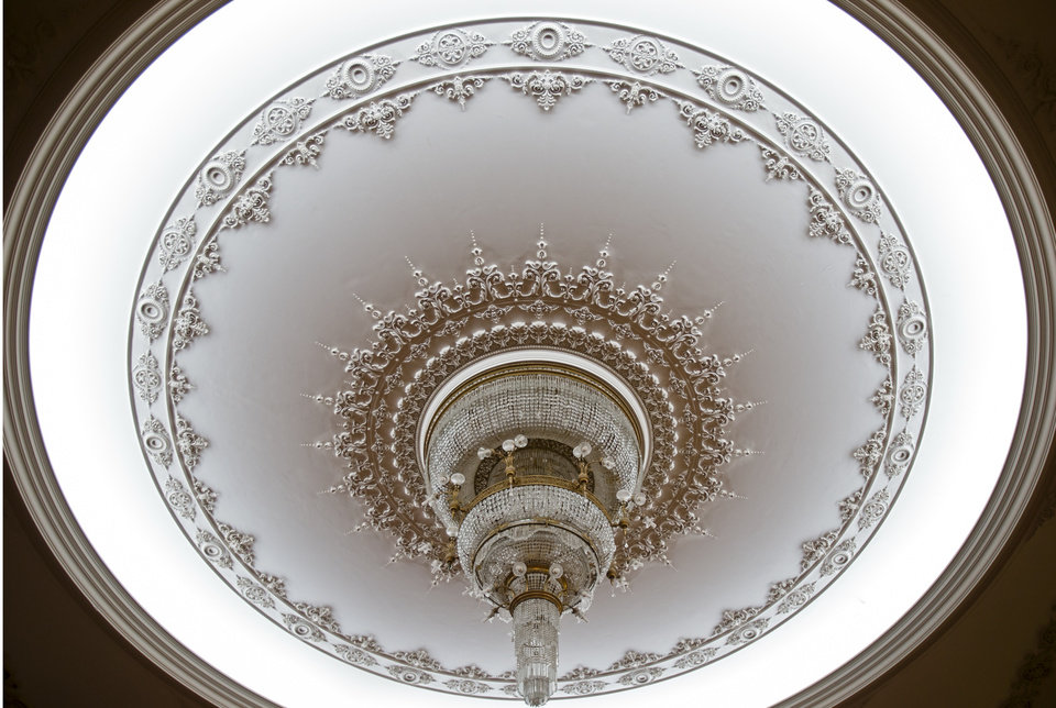 A picture taken on Dec. 12, 2012, shows a ceiling lamp at the Parliament Palace in Bucharest, Romania. Twenty-three years after communism collapsed, the Palace of the Parliament, a gargantuan Stalinist symbol and the most concrete legacy of ex-dictator Nicolae Ceausescu, has emerged as an unlikely pillar of Romania's nascent democracy. And while it remains one of the most controversial projects of Ceausescu's 25-year rule, albeit one that has gradually found a place in the nation's psyche, it's also now a tourist attraction, visited by tens of thousands of Romanians and foreigners every year. (AP Photo/Vadim Ghirda)
