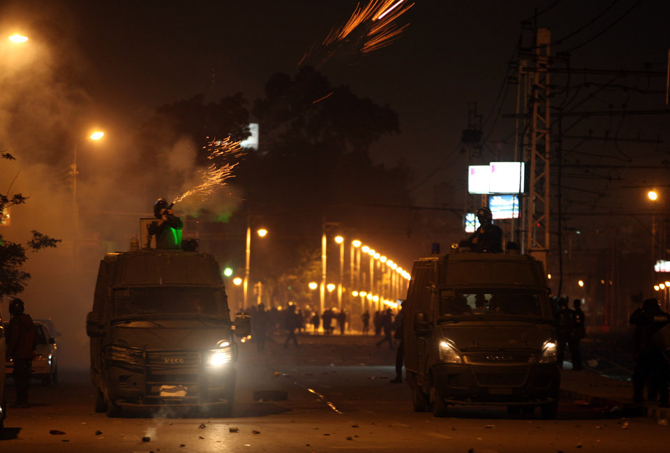 Photo - Egyptian riot police fire tear gas at protesters demonstrating in front of the presidential palace in Cairo, Egypt, Friday, Feb. 1, 2013. Thousands of protesters denouncing Egypt's Islamist president marched on his palace in Cairo on Friday, clashing with security forces firing tear gas and water cannons in the eighth day of the country's wave of political violence. (AP Photo/Khalil Hamra)