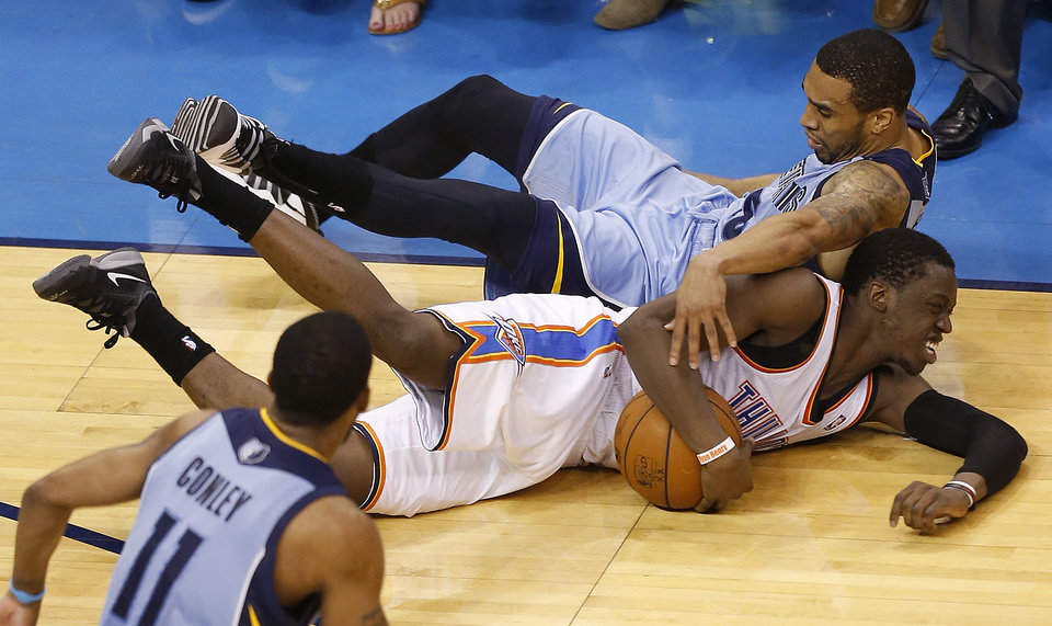 Photo - Oklahoma City's Reggie Jackson (15) fights for a loose ball with Memphis' Courtney Lee (5) during Game 5 in the first round of the NBA playoffs between the Oklahoma City Thunder and the Memphis Grizzlies at Chesapeake Energy Arena in Oklahoma City, Tuesday, April 29, 2014. Photo by Nate Billings, The Oklahoman