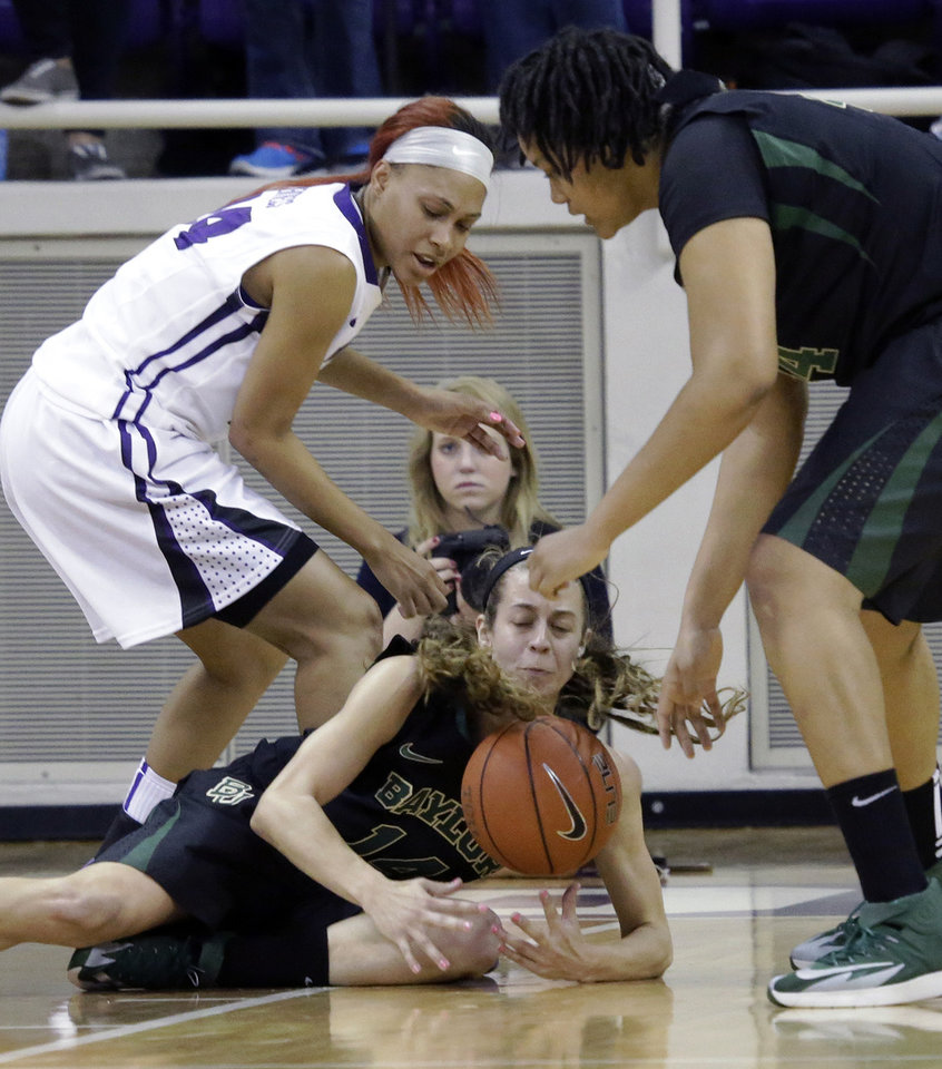 Photo - Baylor center Mariah Chandler (11)  grabs the loose ball against TCU guard Natalie Ventress (24) during the first half of an NCAA college basketball game Saturday, Feb. 22, 2014, in Fort Worth, Texas.  Looking on is Baylor center Kristina Higgins (44), (AP Photo/LM Otero)