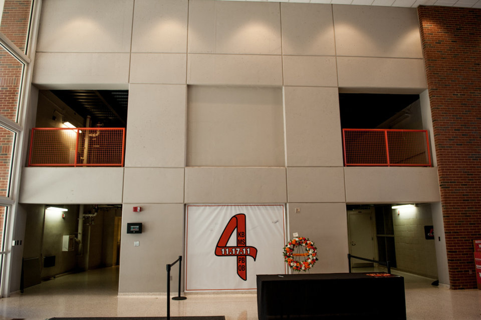 A banner for individuals to sign is hung in Gallagher-Iba Arena on Friday. Saturday is the first anniversary of the airplane crash that killed two Oklahoma State University women's basketball coaches and two OSU supporters. Photo by Mitchell Alcala for The Okahoman <strong>Mitchell Alcala - Mitchell Alcala for the Oklahoma</strong>
