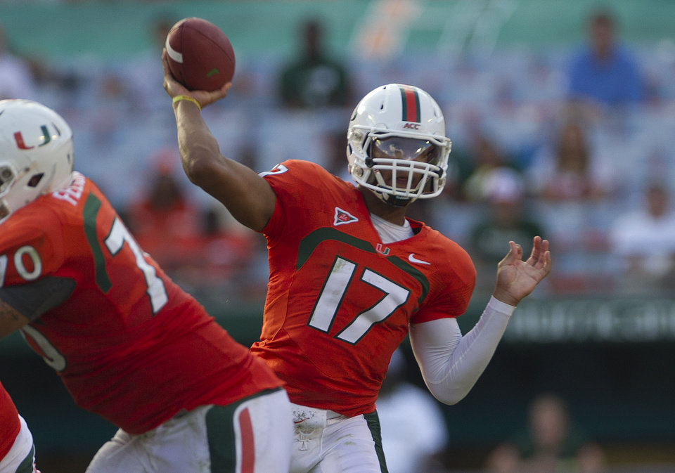 Miami quarter Stephen Morris (17) passes during the second half of a NCAA college football game in Miami, Saturday, Oct. 13, 2012 against North Carolina. North Carolina won 18-14. (AP Photo/J Pat Carter)