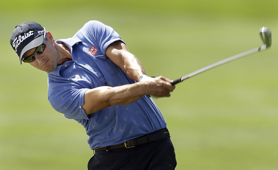 Photo - Adam Scott, of Australia, hits from the first fairway during a pro-am before the start of the Arnold Palmer Invitational golf tournament at Bayhill  Wednesday, March 19, 2014, in Orlando, Fla. (AP Photo/Chris O'Meara)