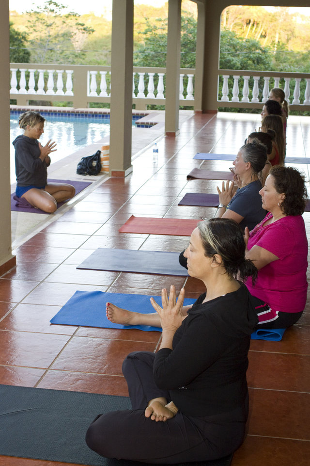 Photo - This March 2011 photo released by Just Love Photography shows a yoga session in Rincon, Puerto Rico, at a retreat created by Jessica Bellofatto of KamaDeva Yoga and Gina Bradley of Paddle Diva. The program is an example of active vacations tailored to travelers who value healthy lifestyles and new experiences. (AP Photo/Evelyn O'Doherty/Just Love Photography)