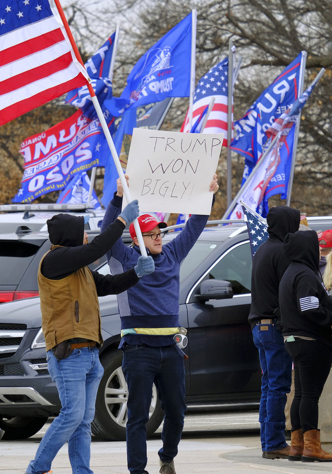 Photo - Supporters of Pres. Donald Trump gathered at the Drive for 45 rally on the south plaza at the Capitol Wednesday, January 6, 2021. [Doug Hoke/The Oklahoman]