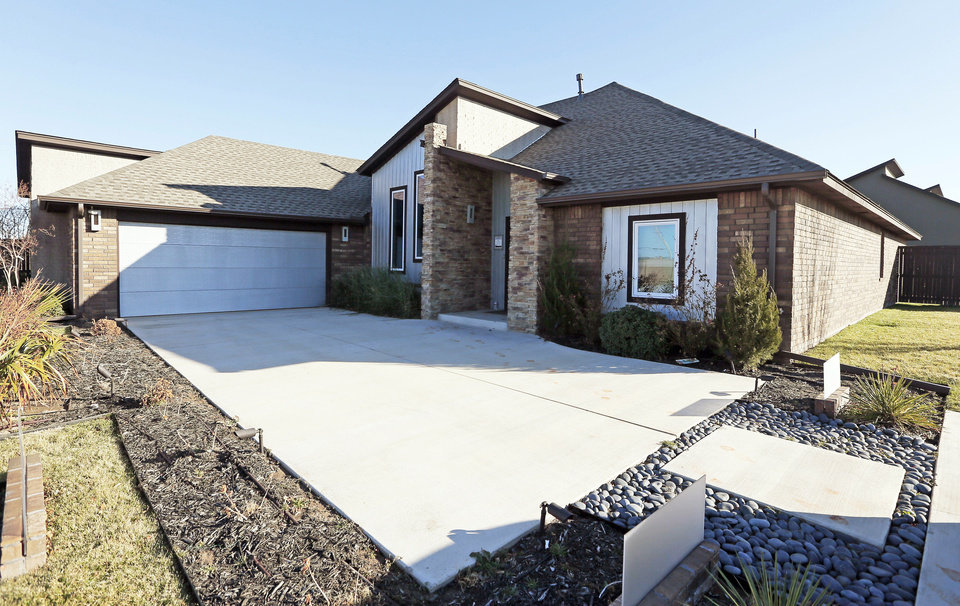 Photo - Jeff Click, president of the Oklahoma State Home Builders Association, built this model home at 17320 White Hawk Drive in the Silverhawk addition in northwest Oklahoma City.