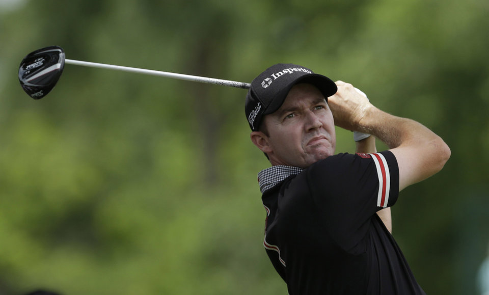 Photo - Jimmy Walker watches his tee shot on the third hole during the final round of the PGA Colonial golf tournament in Fort Worth, Texas, Sunday, May 25, 2014. (AP Photo/LM Otero)