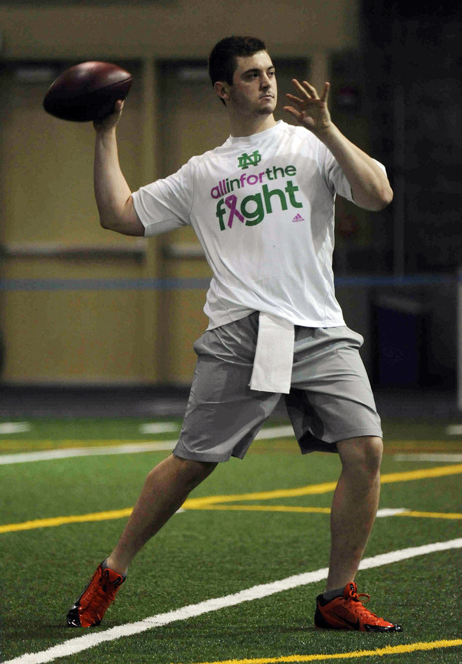 Photo - Notre Dame quarterback Tommy Rees throws during Notre Dame pro day for NFL football representatives Thursday, March 20, 2014, in South Bend, Ind. (AP Photo/Joe Raymond)