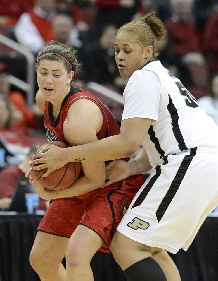 Louisville's Sara Hammond, left, tries to keep the ball away from Purdue's Taylor Manuel, during the second half of their second round game in the women's NCAA college basketball tournament in Louisville, Ky., Tuesday March 26, 2013. Louisville defeated Purdue 76-63. (AP Photo/Timothy D. Easley)