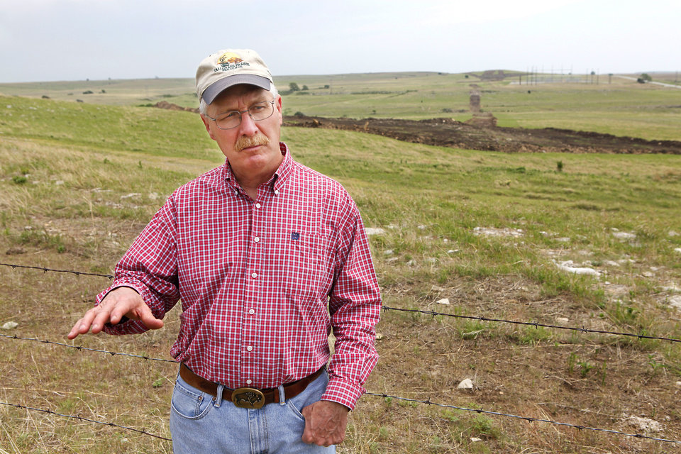 Photo -  Nature Conservancy's Bob Hamilton is seen on one of the proposed wind farm sites.    David McDaniel -  The Oklahoman