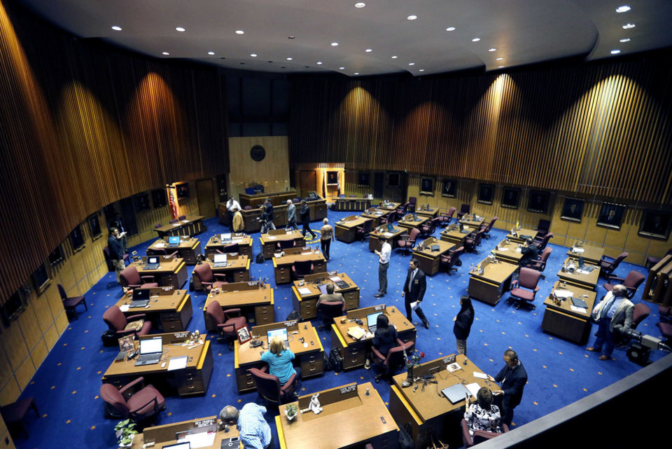 Photo - The Arizona Senate breaks for caucus during a special session for Medicaid funding on Thursday, June 13, 2013, in Phoenix. (AP Photo/Matt York)