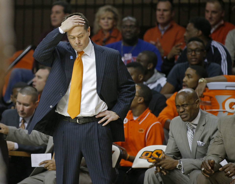 Oklahoma State coach Travis Ford reacts to a play during an NCAA college basketball game between Oklahoma State University (OSU) and Baylor at Gallagher-Iba Arena in Stillwater, Okla., Saturday, Feb. 1, 2014. Baylor won 76-70. Photo by Bryan Terry, The Oklahoman