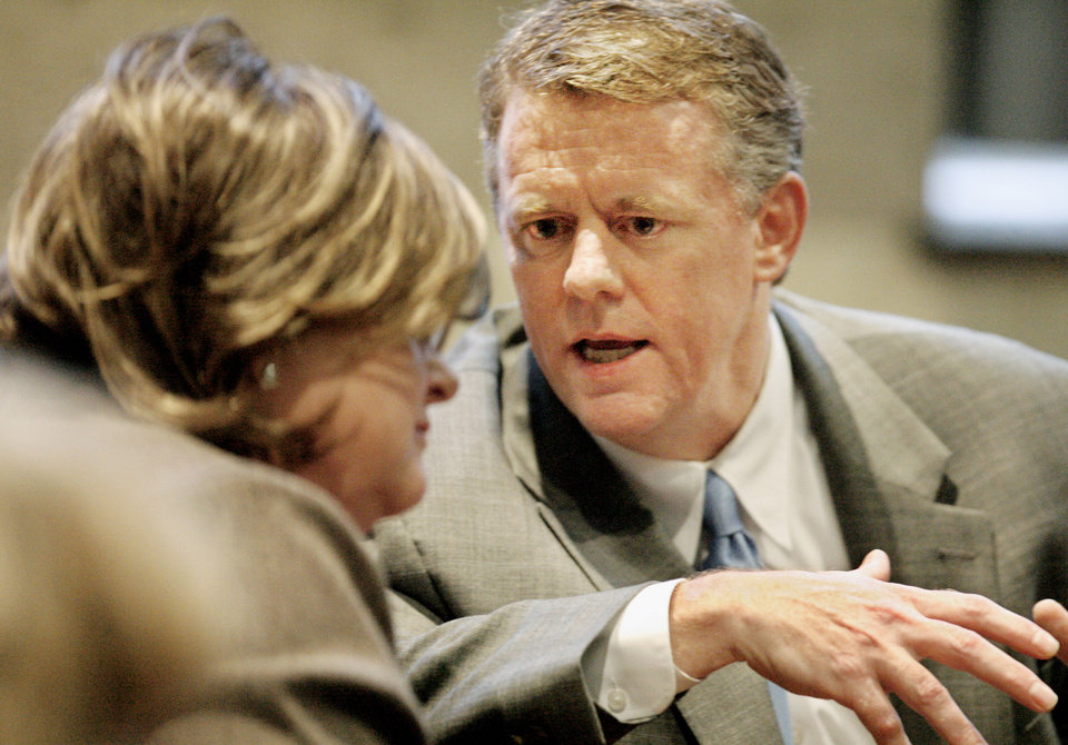 Photo - Paul Jacob talks with Susan Johnson in Oklahoma County District Judge Bryan Dixon's courtroom while waiting for grand jury indictments to be announced at the Oklahoma County Courthouse in Oklahoma City Tuesday, Oct. 2, 2007, BY PAUL B. SOUTHERLAND, The Oklahoman ORG XMIT: KOD