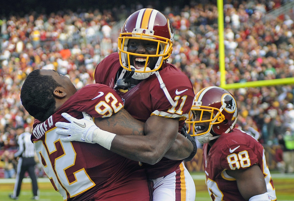 Washington Redskins wide receiver Aldrick Robinson (11)celebrates his touchdown with defensive end Chris Baker (92) during the first half of an NFL football game against the Philadelphia Eagles in Landover, Md., Sunday, Nov. 18, 2012. (AP Photo/Nick Wass)