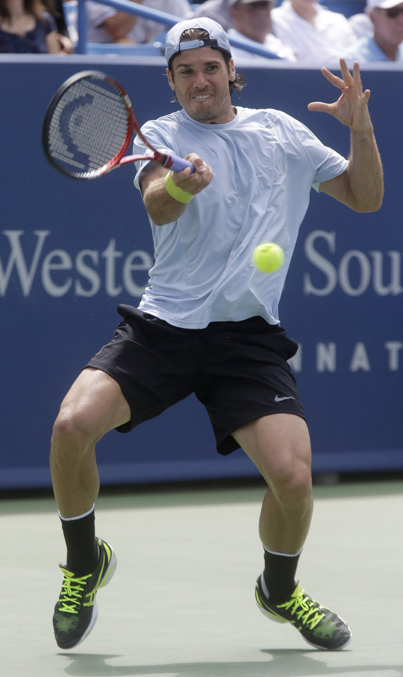 Photo - Tommy Haas, from Germany, hits a forehand to Roger Federer, from Switzerland, at the Western & Southern Open tennis tournament, Thursday, Aug. 15, 2013, in Mason, Ohio. (AP Photo/Al Behrman)