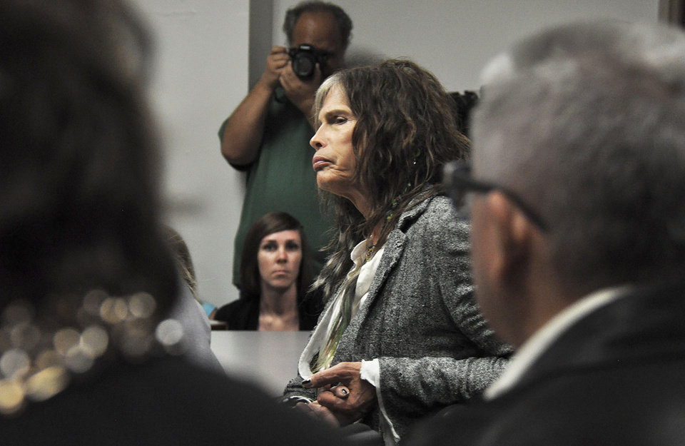 Photo - Aerosmith lead singer Steven Tyler listens to testimony on celebrity privacy during a hearing at the Hawaii Capitol in Honolulu on Friday, Feb. 8, 2013. Rock legends StevenTyler and Mick Fleetwood convinced a Hawaii Senate committee on Friday to approve a bill to protect celebrities or anyone else from intrusive paparazzi. The state Senate Judiciary Committee approved the so-called StevenTyler Act after the stars testified. The bill would give people power to sue others who take photos or video of their private lives in an offensive way. (AP Photo/Anita Hofschneider)
