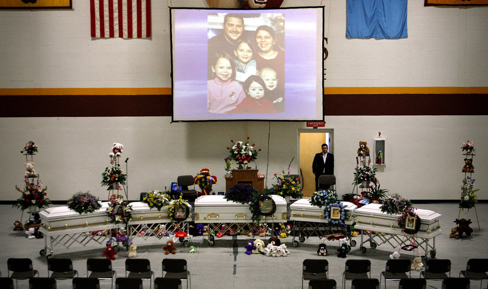 The five caskets of Summer Rust and her four children Kirsten Rust, Autumn Rust, Teagin Rust and Evynn Garas before funeral services in El Reno, Okla. on Wednesday, Jan. 21, 2009. Rust and her children were killed earlier this month in their apartment in El Reno, Okla. PHOTO BY CHRIS LANDSBERGER, THE OKLAHOMAN