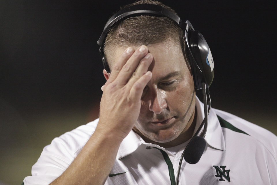 Photo - Norman North head coach Lance Manning walks the sideline as Del City jumps to a three touchdown lead in the first half against Norman North in high school football at Harve Collins Field on Thursday, Sept. 9, 2010, in Norman, Okla.  Photo by Steve Sisney, The Oklahoman