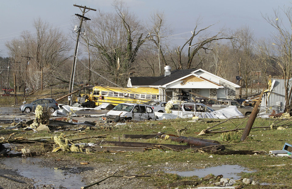 A school bus was thrown into a business across U.S. Highway 31 from Henryville High School in Henryville, Ind., Friday, Mar. 2, 2012 as a result of an apparent tornado touchdown in the community of about 2,000 about 20 miles north of Louisville, Ky. (AP Photo/Garry Jones) ORG XMIT: INGJ102