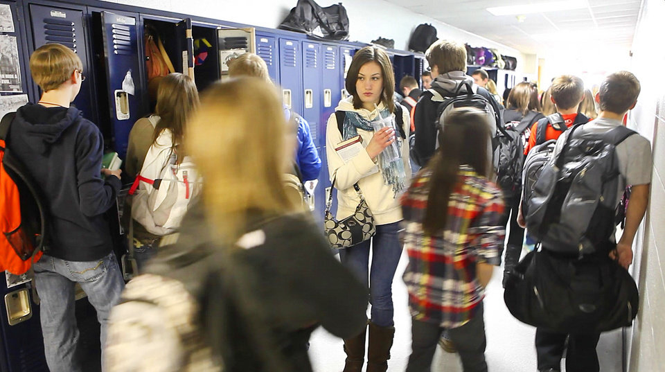 Photo - Mulhall-Orlando students change classes Friday. The district received all A's under the state Education Department's A-to-F school  evaluation system. Photo by David McDaniel, The Oklahoman