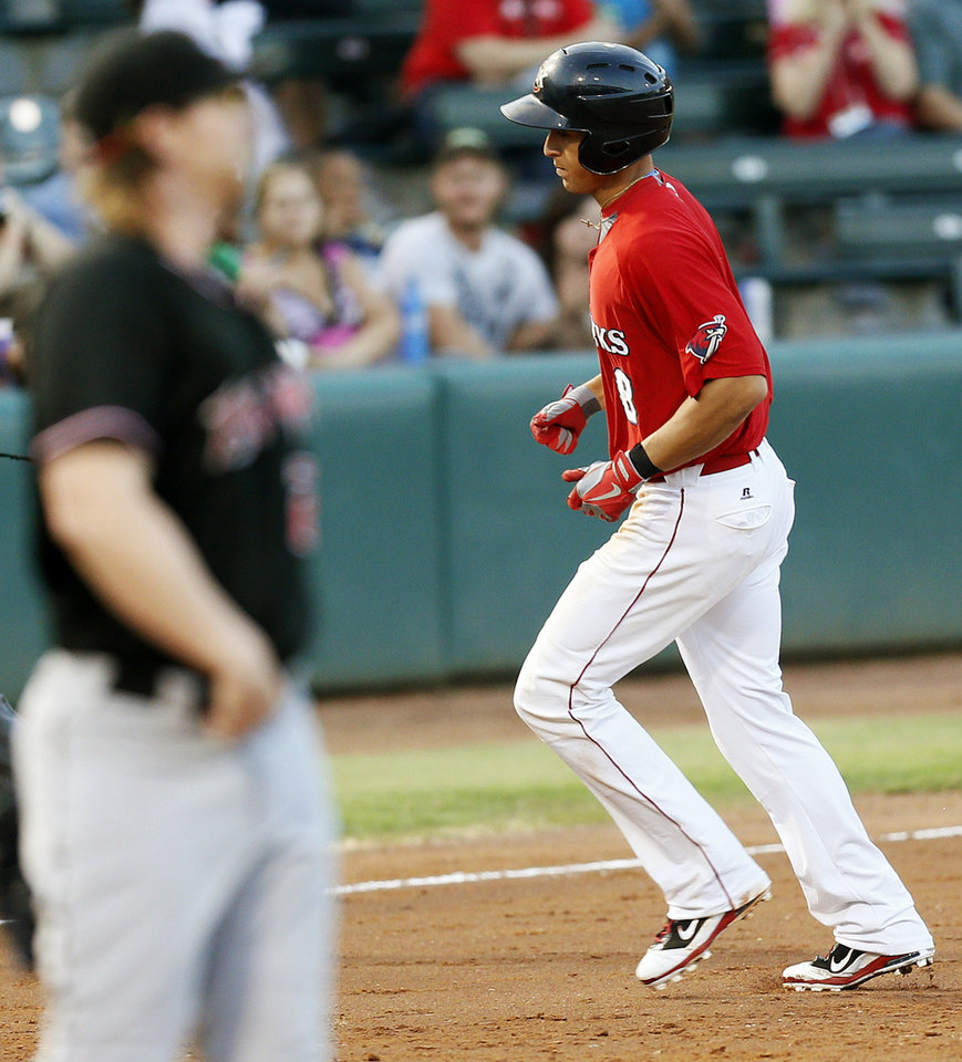 Photo - Oklahoma City's George Springer (8) runs the bases after hitting  home run in the third inning during a minor league baseball game between the Albuquerque Isotopes and the Oklahoma City RedHawks at Chickasaw Bricktown Ballpark in Oklahoma City, Friday, Aug. 16, 2013. Photo by Nate Billings, The Oklahoman