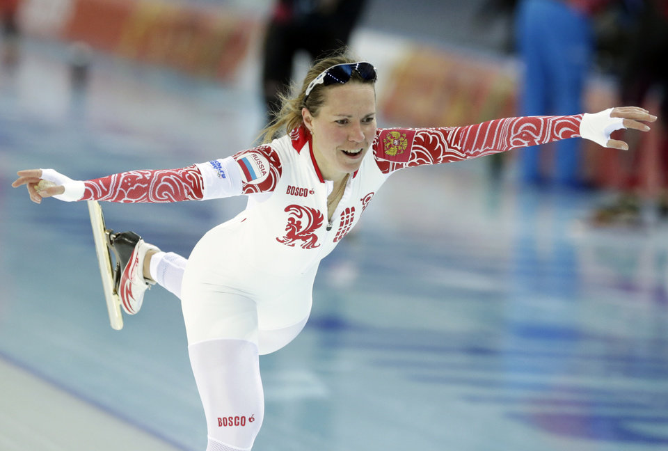 Photo - Russia's Olga Graf celebrates her time after competing in the women's 3,000-meter speedskating race at the Adler Arena Skating Center during the 2014 Winter Olympics, Sunday, Feb. 9, 2014, in Sochi, Russia. (AP Photo/Matt Dunham)