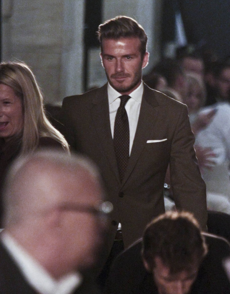 Photo -   David Beckham arrives at the show for Victoria Beckham's Spring 2013 fashion collection on Sunday, Sept. 9, 2012 in New York. (AP Photo/Bebeto Matthews)