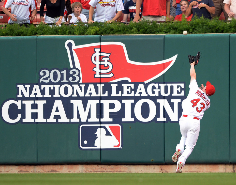 Photo - St. Louis Cardinals' Shane Robinson (43) catches a ball off the bat of San Diego Padres' Tommy Medica in the first inning in a baseball game, Thursday, Aug. 14, 2014, at Busch Stadium in St. Louis. (AP Photo/Bill Boyce)