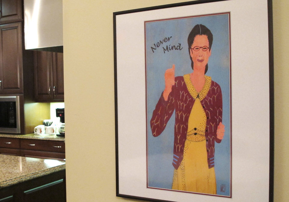 A framed image of comedian Gilda Radner hangs on the wall inside the cancer support group Gilda's Club Madison on Wednesday, Nov. 27, 2012, in Middleton, Wis. The Madison-area chapter of the national group is the latest to change its name to the Cancer Support Community, a move its director said was necessary because young people don't know who Radner was.  (AP Photo/Scott Bauer)