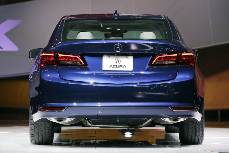 Photo - The 2015 Acura TLX is introduced at the 2014 New York International Auto Show at the Javits Convention Center, in New York, Wednesday, April 16, 2014. (AP Photo/Richard Drew)