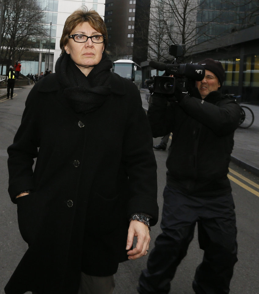 Photo - CORRECTS SPELLING OF SOUTHWARK   Detective Chief Inspector April Casburn of the London Metropolitan Police leaves Southwark Crown Court in London, Thursday, Jan. 10, 2013. Casburn has been found guilty of offering the now-defunct tabloid, The News of the World,  information about Operation Varec, the investigation into whether Scotland Yard's inquiry into phone hacking should be reopened. (AP Photo/Kirsty Wigglesworth)