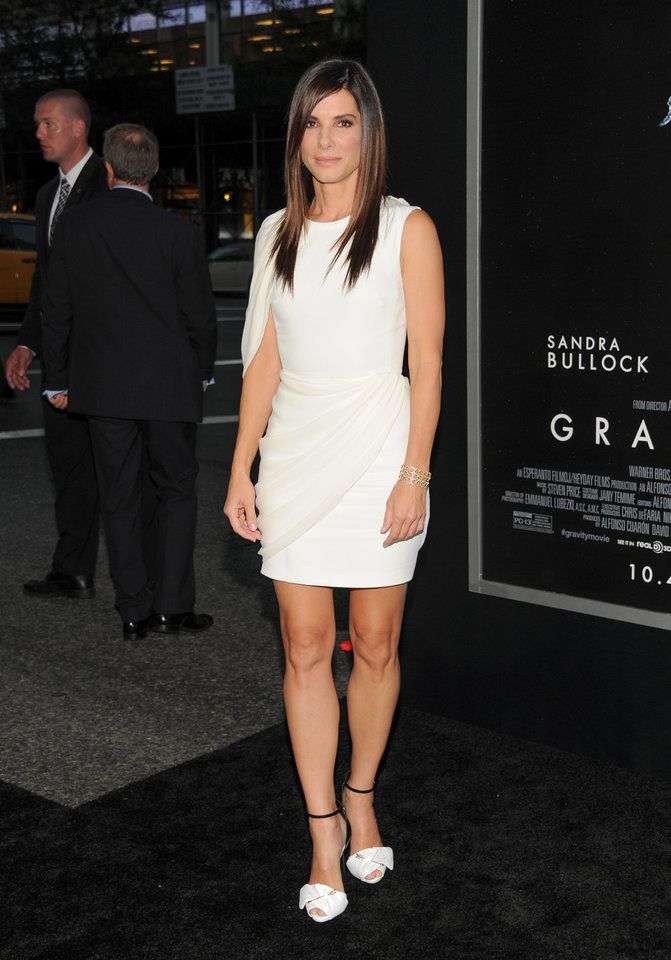 "Actress Sandra Bullock attends the premiere of ""Gravity"" at the AMC Lincoln Square Theaters on Tuesday, Oct. 1, 2013, in New York. (Photo by Evan Agostini/Invision/AP) ORG XMIT: NYEA104"