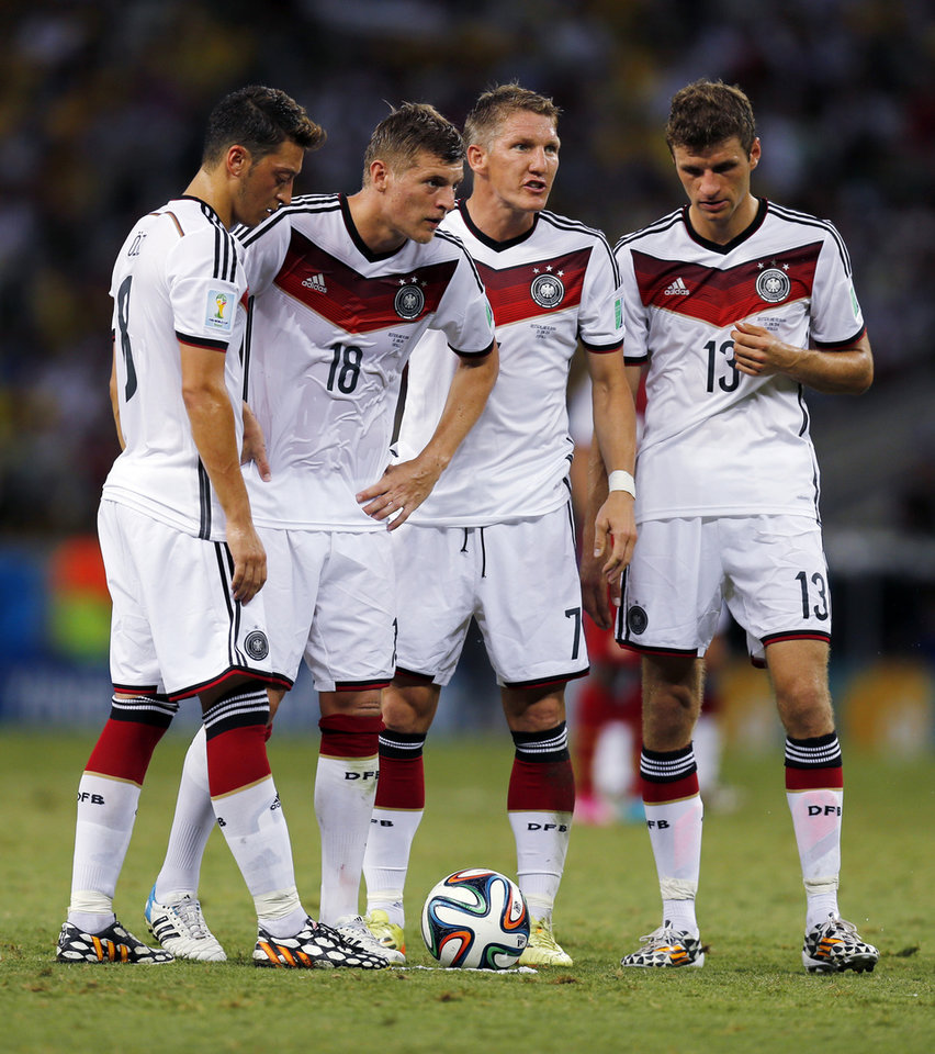 Photo - From leftL Germany's Mesut Ozil, Toni Kroos, Miroslav Klose and Thomas Mueller stand over a free kick during the group G World Cup soccer match between Germany and Ghana at the Arena Castelao in Fortaleza, Brazil, Saturday, June 21, 2014. (AP Photo/Frank Augstein)
