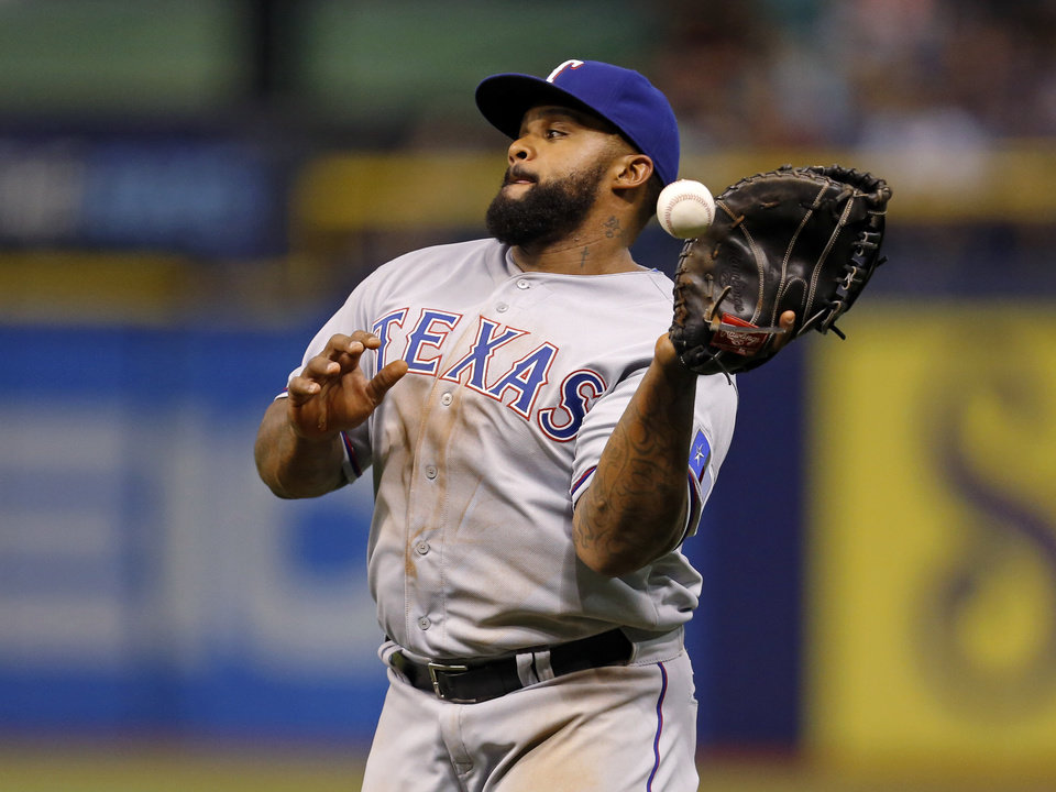 Photo - Texas Rangers first baseman Prince Fielder drops a foul ball hit by Tampa Bay Rays' Brandon Guyer during the fifth inning of a baseball game Friday, April 4, 2014, in St. Petersburg, Fla. (AP Photo/Mike Carlson)